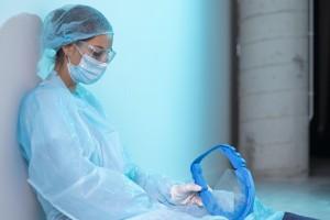 tired-female-doctor-sitting-hallway-hospital